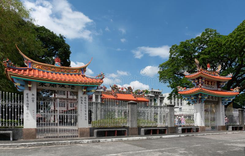 Fence and gates to temple and prayer hall at Chinese Cemetery in Manila Philippines. Manila, Philippines - March 5, 2019: Chinese Cemetery in Santa Cruz part of stock photo