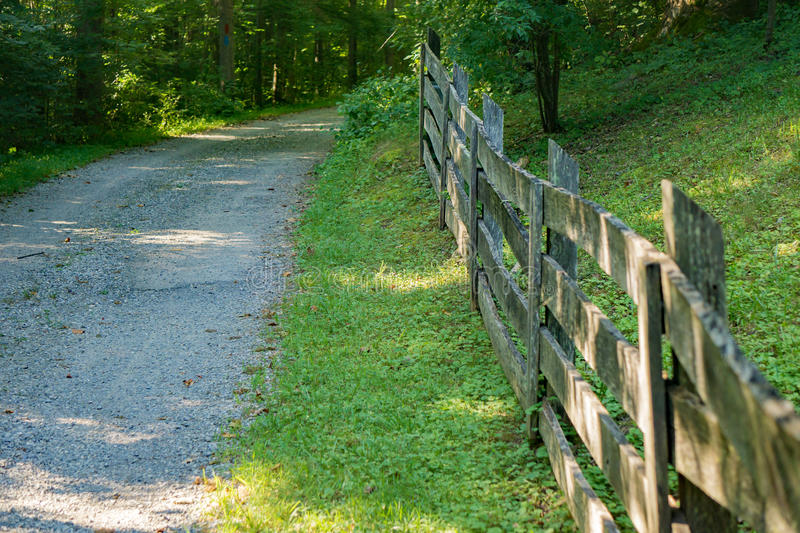 Fence Line a Country Lane in the Blue Ridge Mountains. A country lane with old rustic fence located in the Blue Ridge Mountains of Virginia, USA stock photo