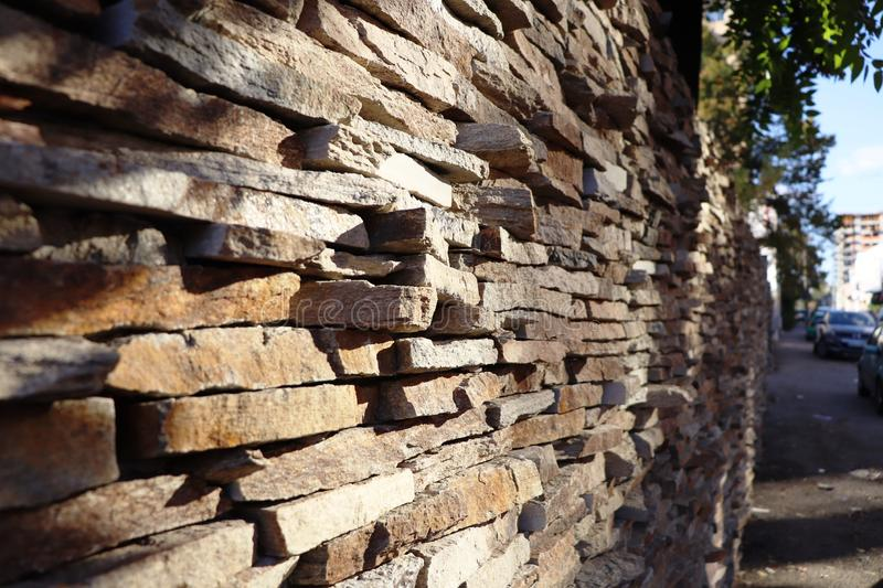 A fence lined with pieces of stone stock photography