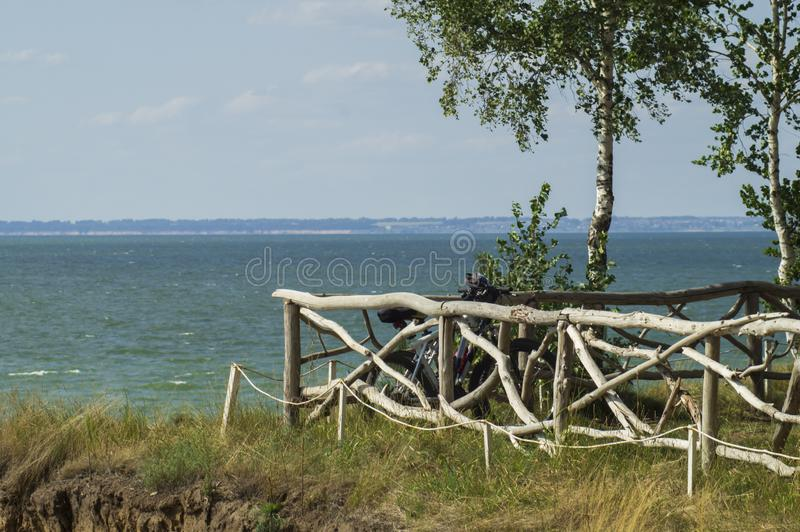 Fence made of natural curves of tree branches. The fence is made of natural curves of tree branches in the Park to relax on the background of the sea stock photos