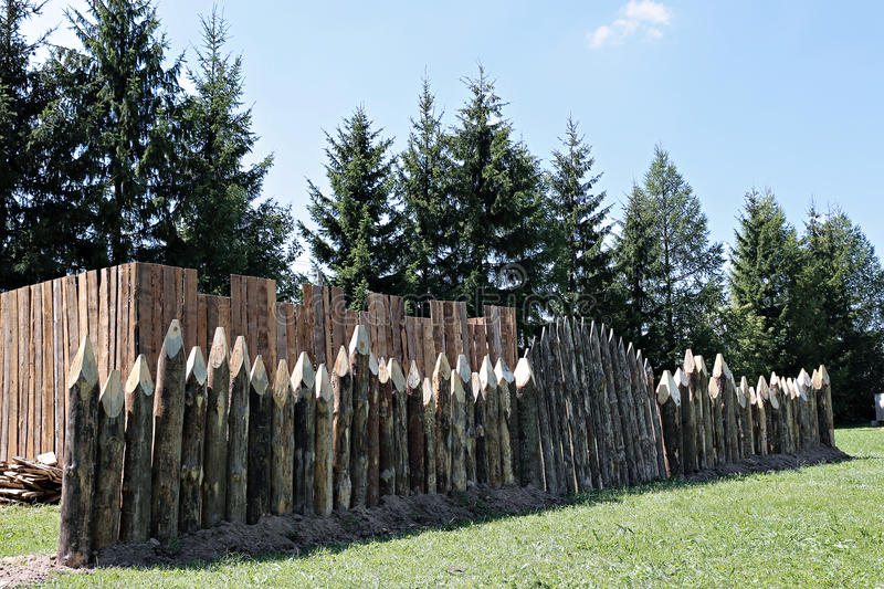 Fence made of sharpened pointed logs royalty free stock photography
