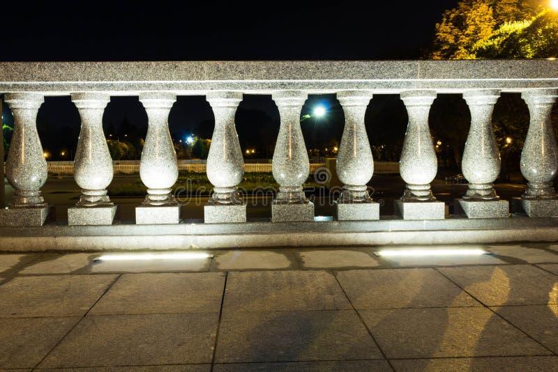 Fence, marble pillars with illuminated lanterns. Evening. Fence, marble pillars with illuminated lanterns. Fence, marble pillars with illuminated lanterns royalty free stock photo