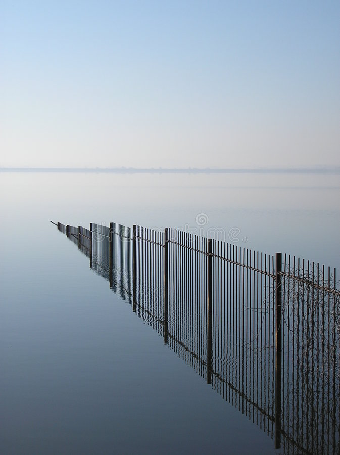 Free Fence Mirror Reflection In The Water Stock Image - 4720071