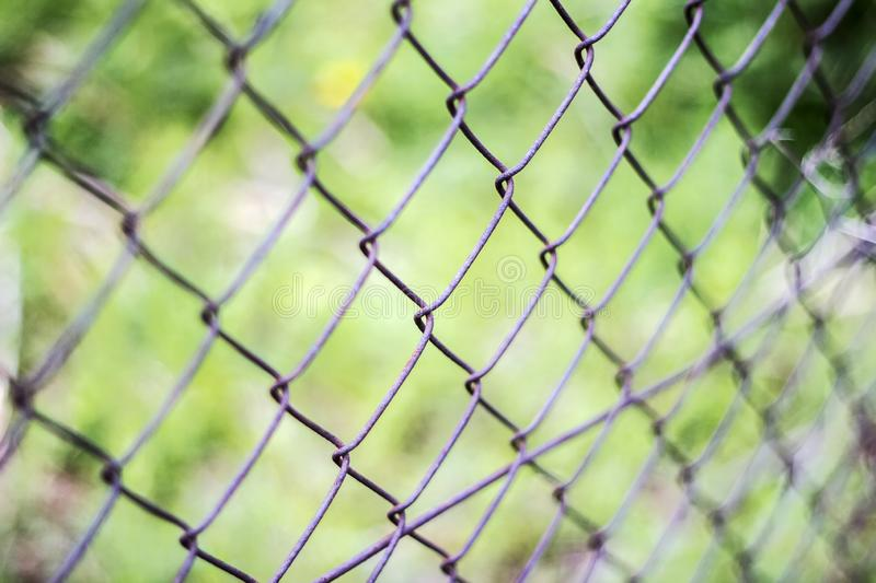 Fence netting, concept of limit for a fence to be locked. Close up pattern Barb Wire royalty free stock image