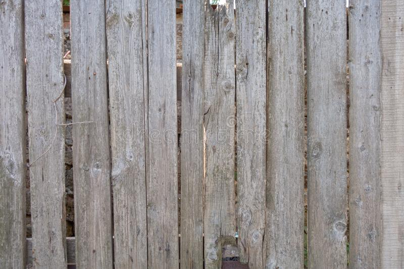 Fence from old weathered pine boards. Texture of natural aged wood. Woodworm holes, rusty nails. Creative vintage background. Close, closeup, metal, wall, dark stock images