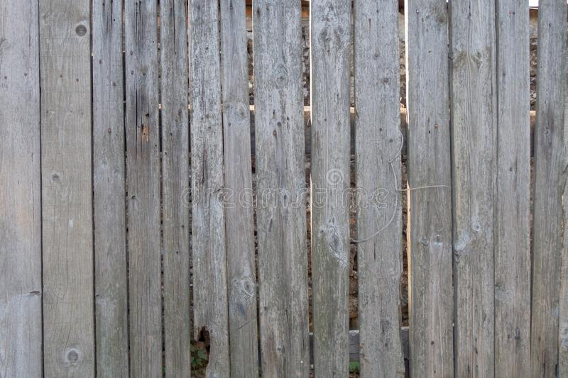 Fence from old weathered pine boards. Texture of natural aged wood. Woodworm holes, rusty nails. Creative vintage background. Close, closeup, metal, wall, dark stock image