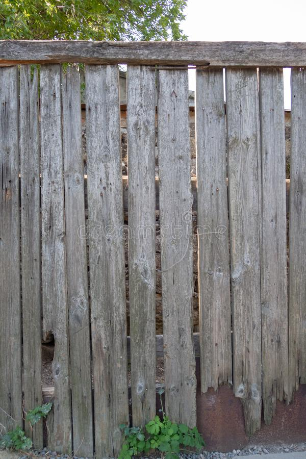 Fence from old weathered pine boards. Texture of natural aged wood. Woodworm holes, rusty nails. Creative vintage background. Close, closeup, metal, wall, dark stock photos