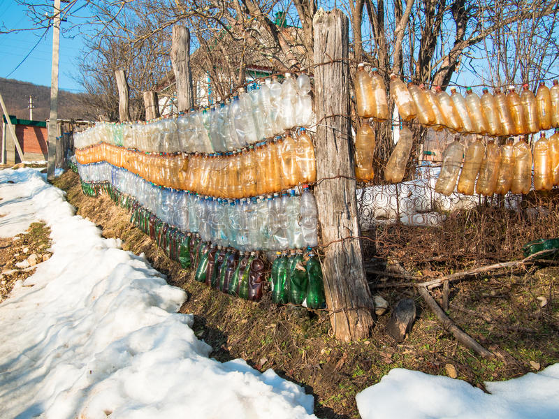 Fence of plastic bottles royalty free stock images