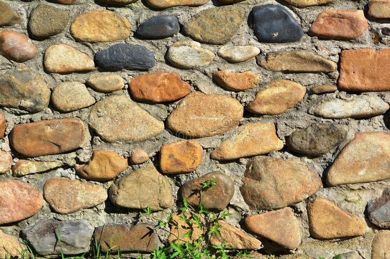 A fence of poorly processed natural stone stock photo