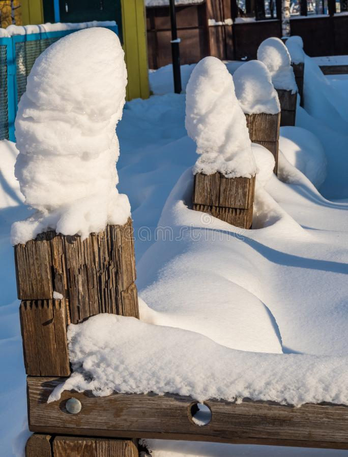 The fence posts in snow caps in Novosibirsk, Russia.  stock photo