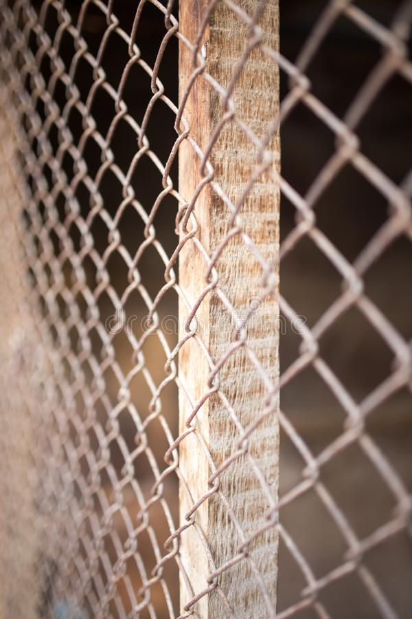 A fence of rusty metal mesh stock photos