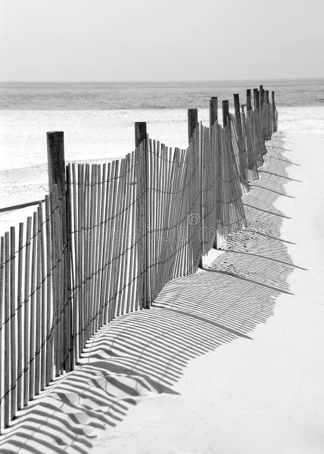 Fence and Shadow on Beach stock photo
