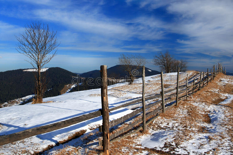 Fence on top of a snowy mountain stock images