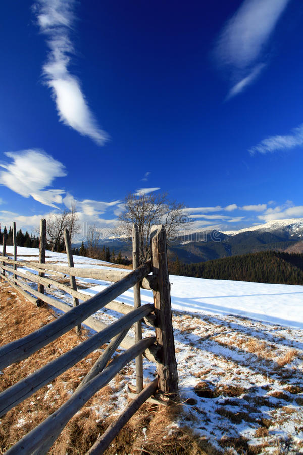 Fence on top of a snowy mountain royalty free stock photos