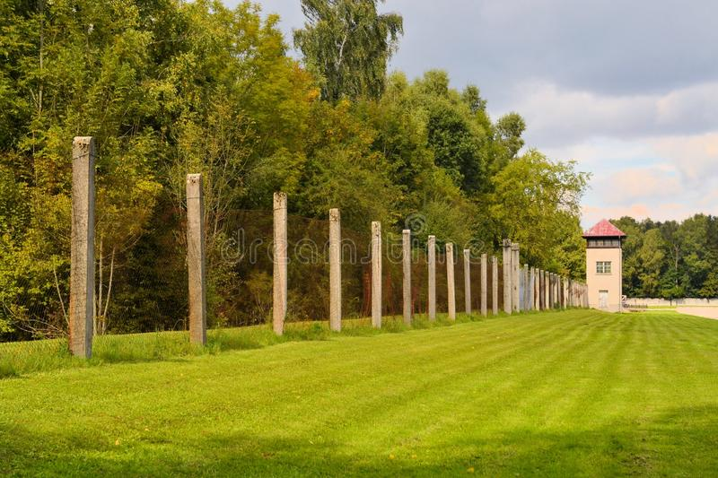 Fence and watch tower at Dachau concentration camp stock image