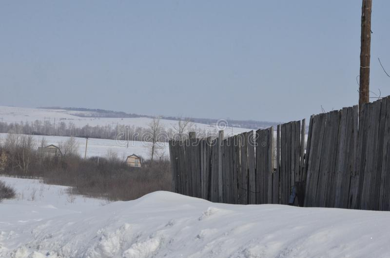 March. Sparkling snow in large drifts lying on the roadside royalty free stock photography