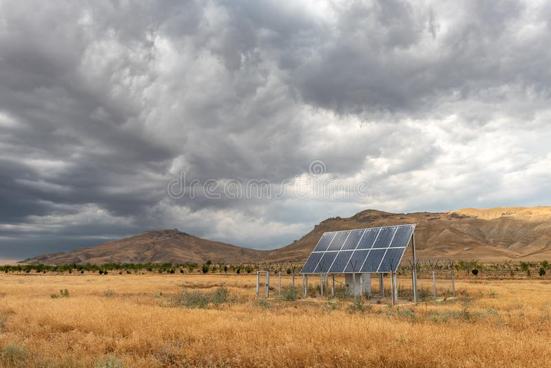 Fenced solar panel in the field royalty free stock image