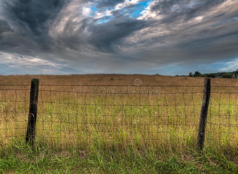 Download Fenceline And Dramatic Clouds Stock Photo - Image: 33443404