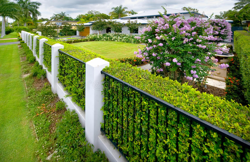 Fenceline to house royalty free stock images