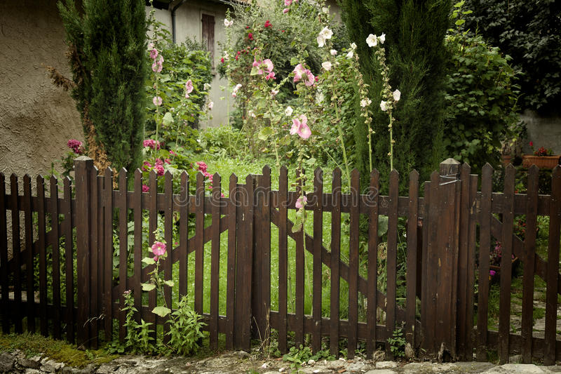 Fences. In a garden of a ouse in a village stock images