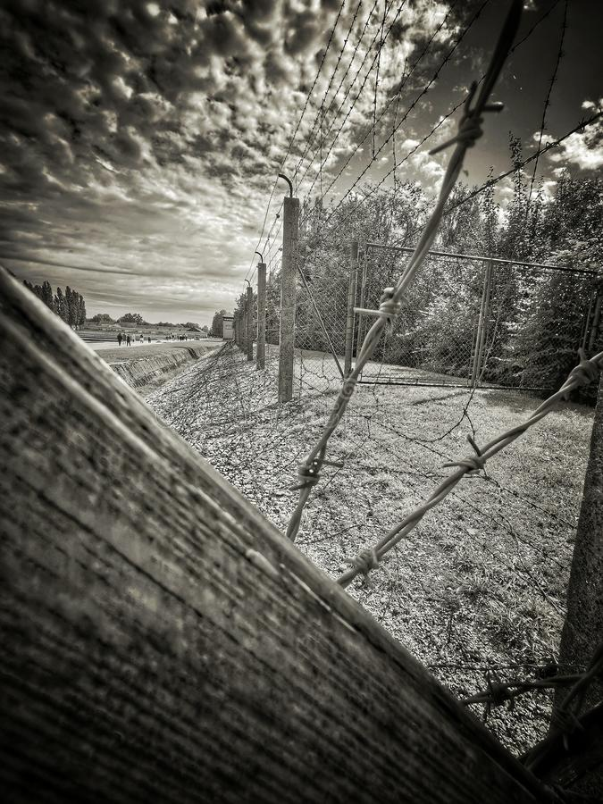 Nazi concentrationcamp Dachau fences on a rainy day royalty free stock image