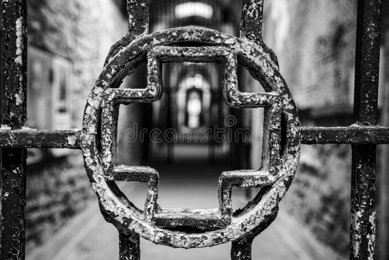 Fences leading to the hospital. Entrance to an infirmary in an abandoned penitentiary in disrepair royalty free stock image