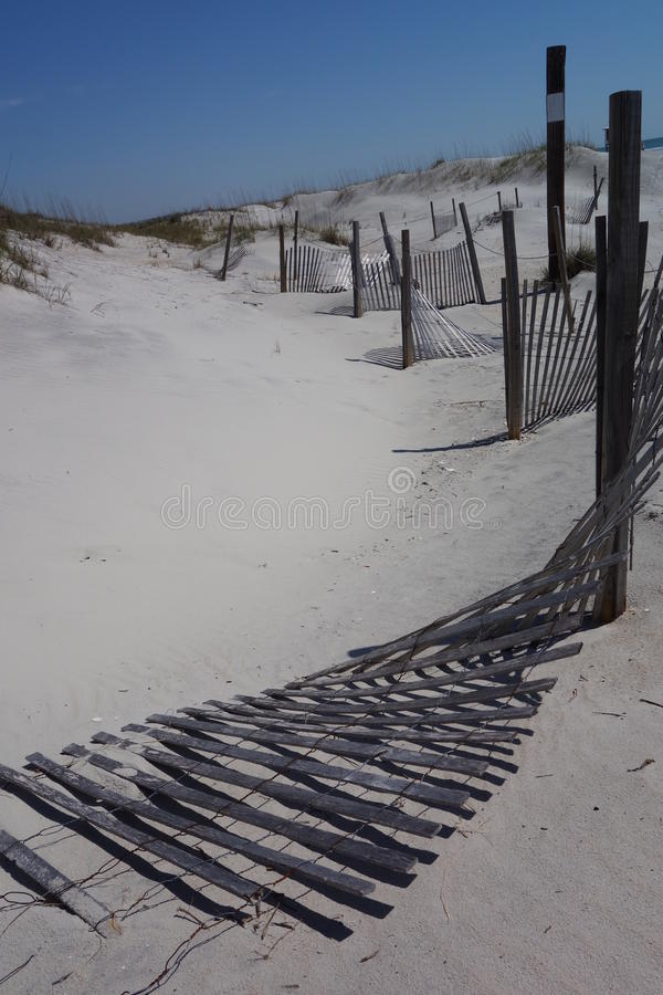 Download Fences On White Sandy Beach Stock Image - Image: 30997771