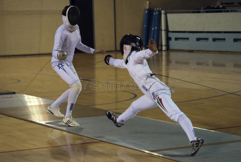 Fencing-1. BELGRADE,SERBIA-DECEMBER1:Fencer Marinuk Avital(ISR) fight against Mihaly Kata(HUN) on the 57. International Trophy of Belgrade Mihaly won.December1 royalty free stock photo