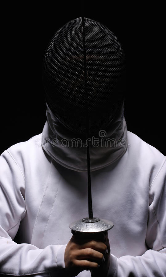 Fencing. Man with a sword isolated on black royalty free stock images