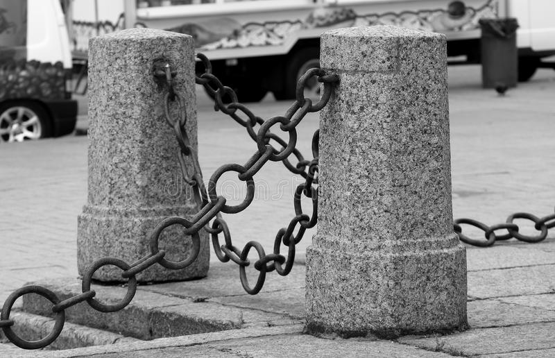 Fencing of concrete pillars connected by a chain stock image
