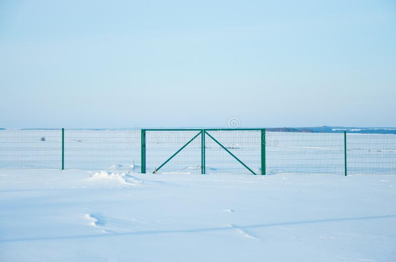 Fencing in the field in winter. stock photography