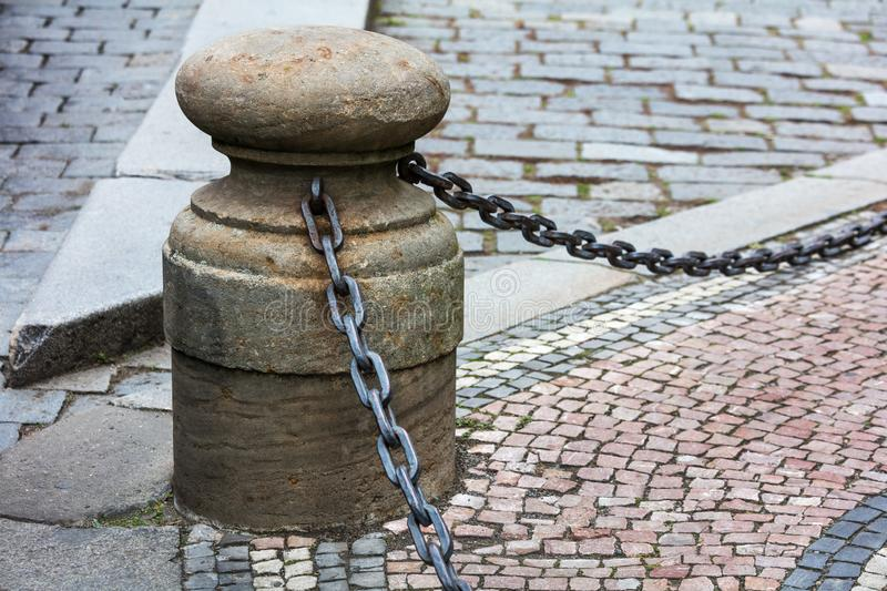Fencing in form of posts with iron chains. Fencing of sidewalk in form of posts with iron chains royalty free stock photos
