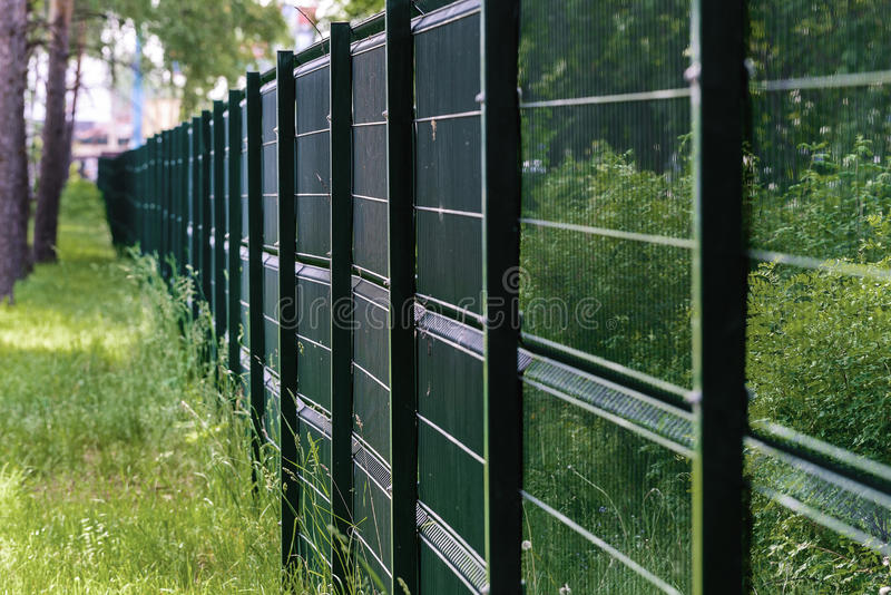 Fencing made of metal mesh to protect royalty free stock photos