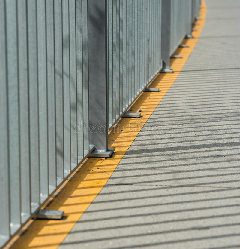 Fencing. Metal fence of the bridge for pedestrians and shadows from the fence royalty free stock image
