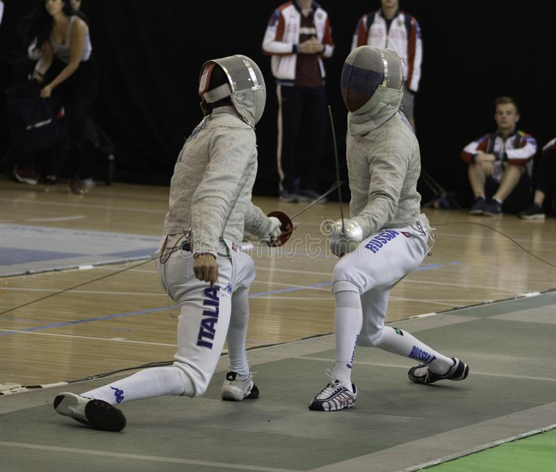 Fencing players competing World Championship royalty free stock photo