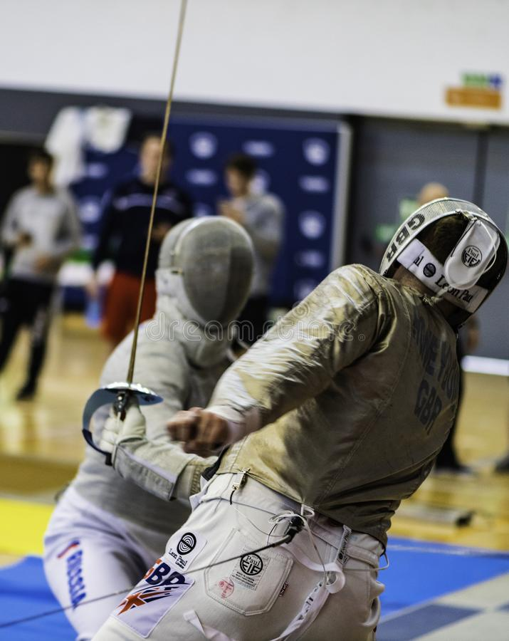 Fencing players competing World Championship royalty free stock images