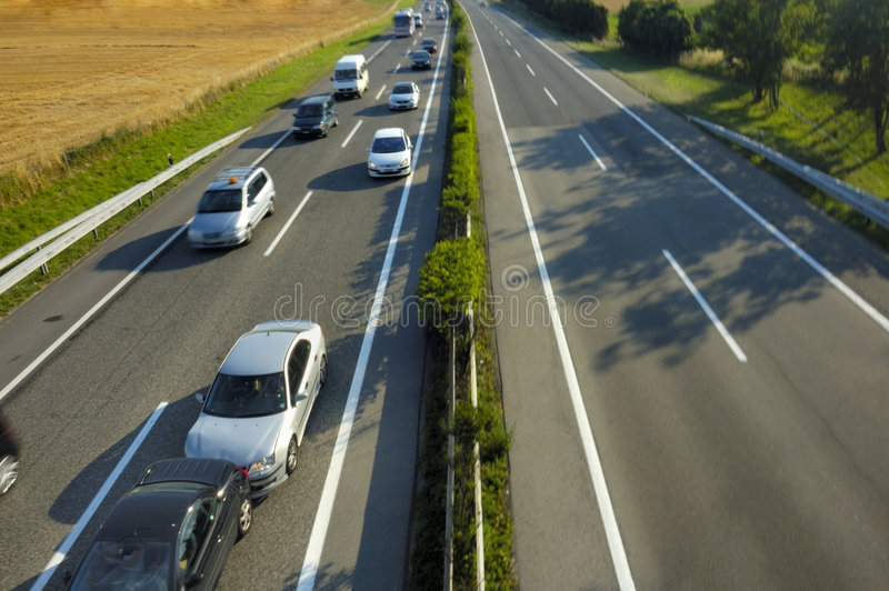 Fender Bender. A small shunt on the freeway (motorway, autoroute, autobahn) at the instant it happened stock photography