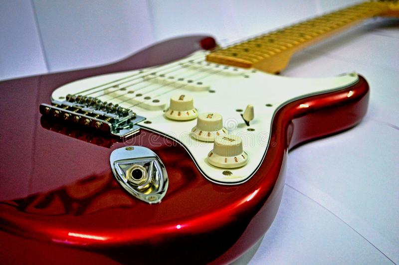 fender squier stratocaster electric guitar stock photo image of shiny background 69650774. Black Bedroom Furniture Sets. Home Design Ideas