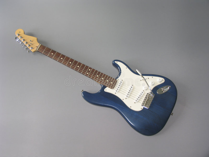 Fender Stratocaster Guitar. Full size electric guitar in blue stock photo