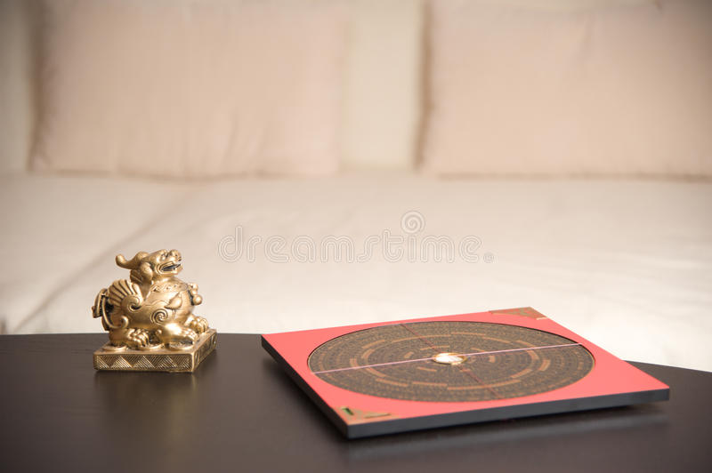 Feng Shui. An asian symbol and a Feng Shui compass on a table royalty free stock photos