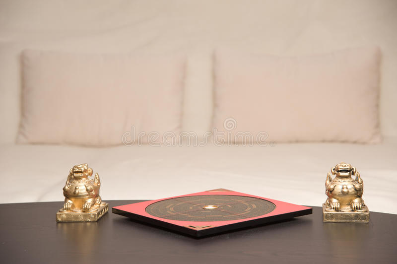 Feng Shui. An asian symbol and a Feng Shui compass on a table royalty free stock photography