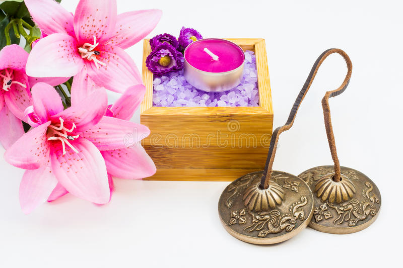 Feng shui concept. Studio shot tibetan cymbals and some alternative therapy elements stock photography
