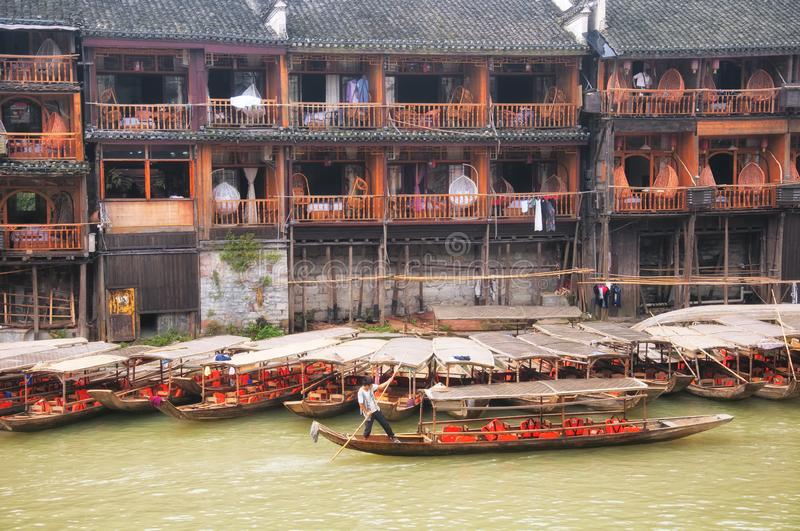 Fenghuang ancient town china and Tuo jiang river tourist boats royalty free stock photos