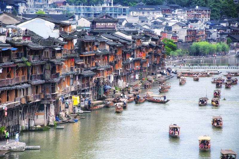 Fenghuang ancient town china and Tuo jiang river tourist boats royalty free stock photography