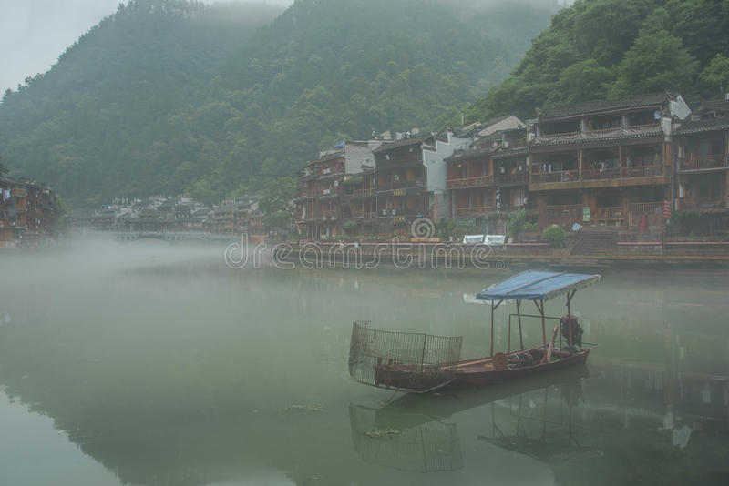 Fenghuang boat in morning stock image