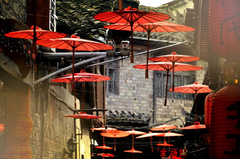 Fenghuang, China - May 15, 2017: The decoration of red umbrella on the streets of Fenghuang Ancient Town Phoenix ancient town. stock photos