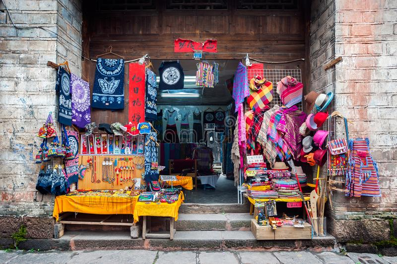 Street stall in Fenghuang ancient town, China, selling tradition. FENGHUANG, CHINA - NOV 12, 2014 - Street stall in Fenghuang ancient town, China, selling royalty free stock image