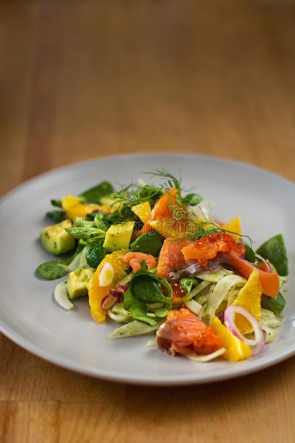 Fennel salad with smoked salmon, orange and avocado stock images