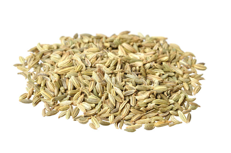 Fennel seeds. Pile of raw fennel seeds isolated on white stock photo