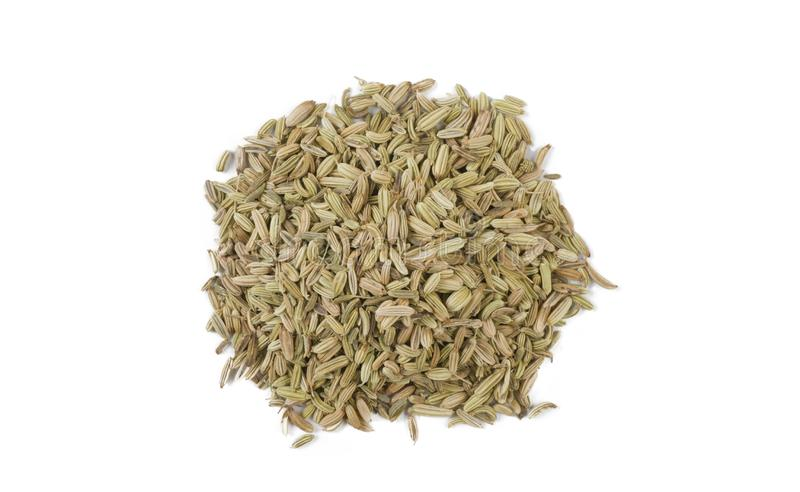 Fennel seeds heap isolated on white background. top view royalty free stock photo